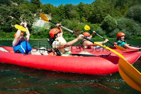 fun splashing canoe river  Stock photo © vilevi