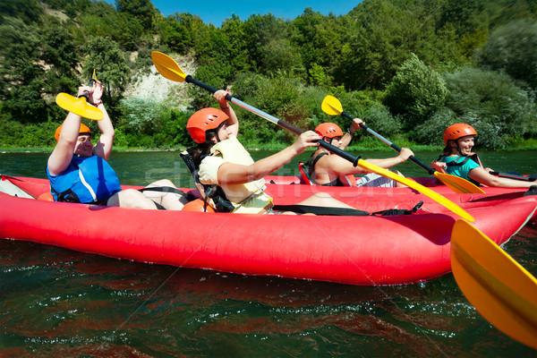 каноэ рафтинга реке два Команды красный Сток-фото © vilevi