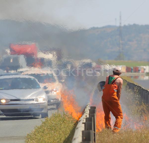 Autostrady ognia korku drogowego pracownika w górę Zdjęcia stock © vilevi