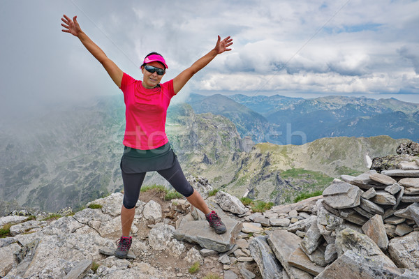 Female Mountain Peak Pose Stock photo © vilevi