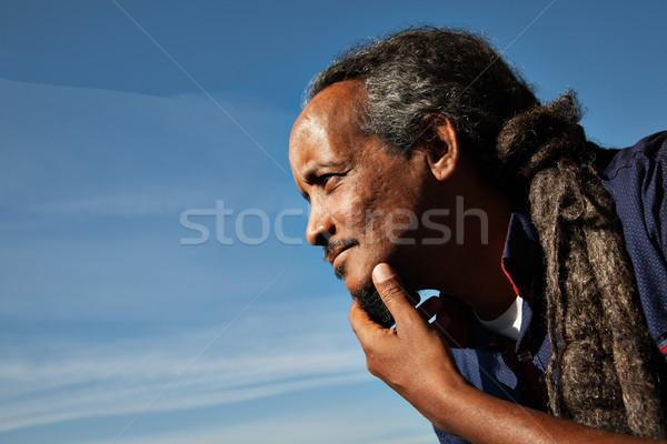 человека черный портрет небе Blue Sky улыбка Сток-фото © vilevi