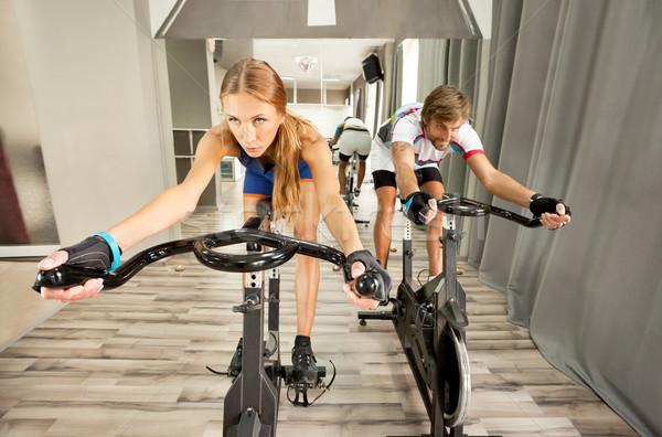 Bisiklete binme spor salonu güzel bir kadın adam genç Stok fotoğraf © vilevi