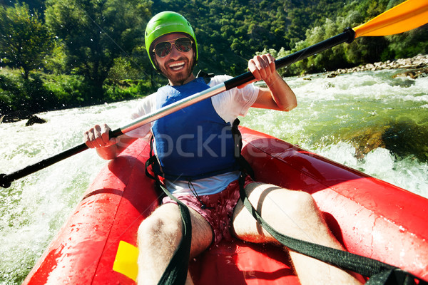 Stock fotó: Boldog · férfi · vadvizi · evezés · fiatalember · piros · felfújható