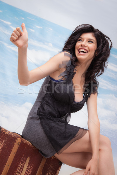 Hitchhiking Girl Laughing Stock photo © vilevi