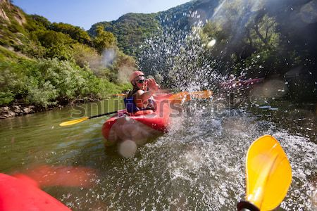 in river canoe splashes Stock photo © vilevi
