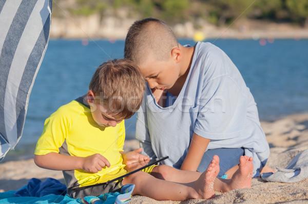 Kids Beach Tablet Stock photo © vilevi