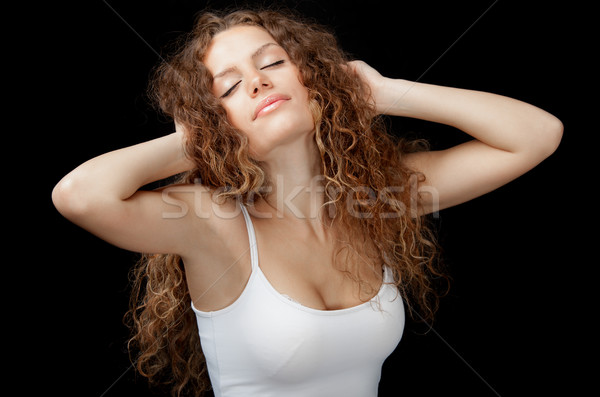 Beautiful girl stretching Stock photo © vilevi