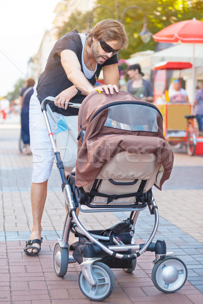 Young Father Stroller Stock photo © vilevi