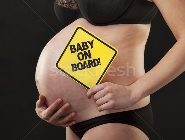 Embarazadas cerca abdomen signo mujer embarazada primer plano Foto stock © vilevi
