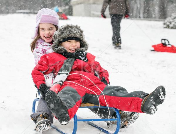 Kids Sledding Fun Snow Stock photo © vilevi