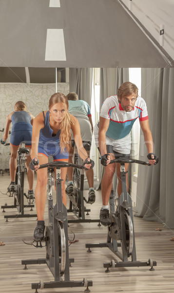 Young Active People Gym Cycling Stock photo © vilevi