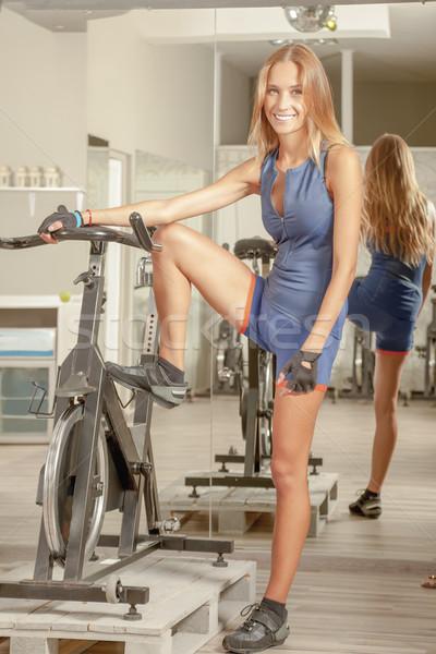 Beautiful Young Woman Cycling Gym Stock photo © vilevi