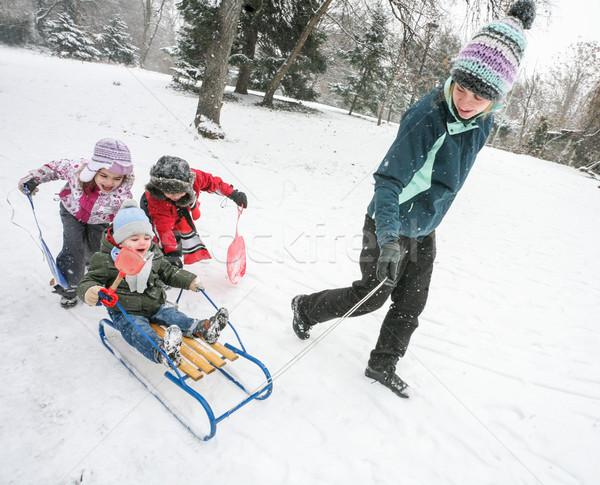 Mother Kids Snow Fun Sled Stock photo © vilevi