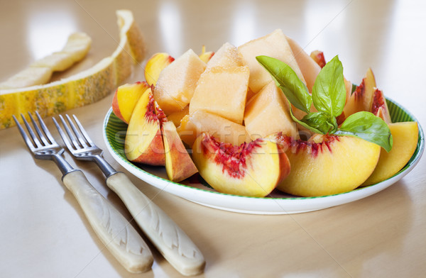 sliced fruits peach melon Stock photo © vilevi