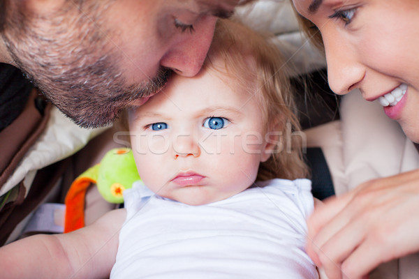 baby parents family attention frowning Stock photo © vilevi