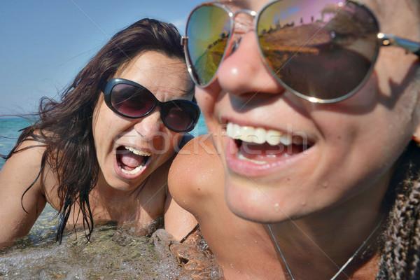 Sorridere urlando femminile facce mare occhiali da sole Foto d'archivio © vilevi