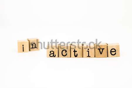 split inactive wording, active wording for motivation concept Stock photo © vinnstock