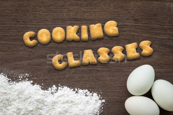 Letter biscuits word COOKING CLASSES on kitchen table background Stock photo © vinnstock