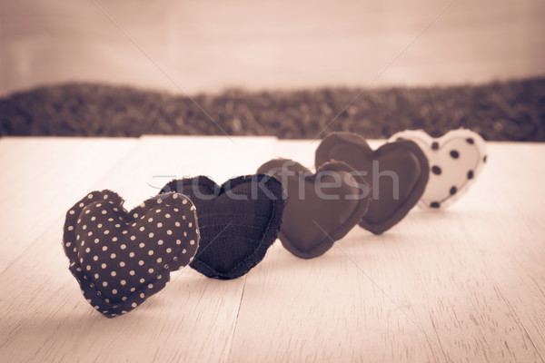 Love hearts on wood background, sepia and retro style Stock photo © vinnstock