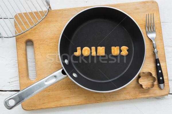 Letter cookies word JOIN US and kitchen utensils Stock photo © vinnstock