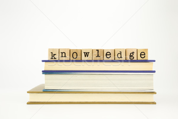 knowledge word on wood stamps and books Stock photo © vinnstock