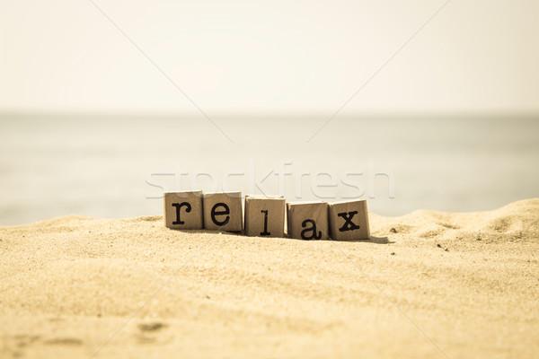 Relaxing beach break on holiday, retro style image Stock photo © vinnstock