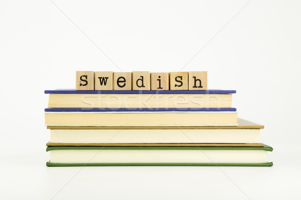 Stock photo: swedish language word on wood stamps and books