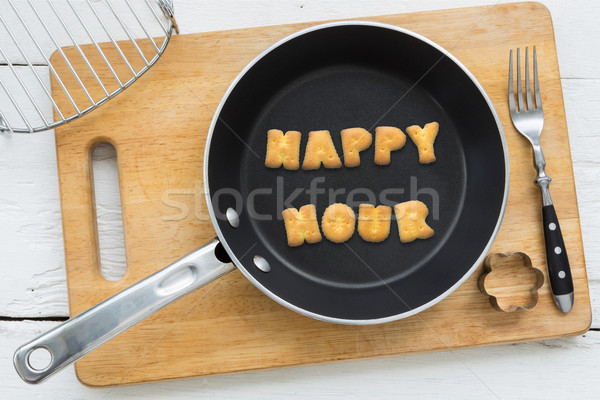 Letter biscuits word HAPPY HOUR and cooking equipments. Stock photo © vinnstock