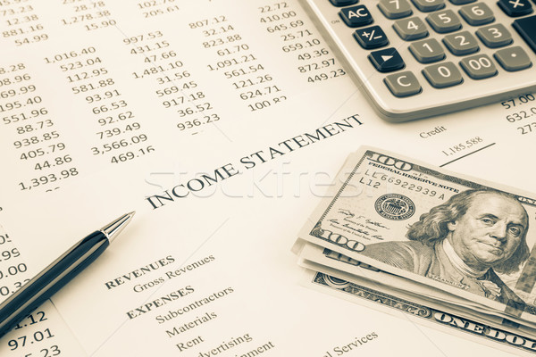 Money and income statement report in sepia tone Stock photo © vinnstock