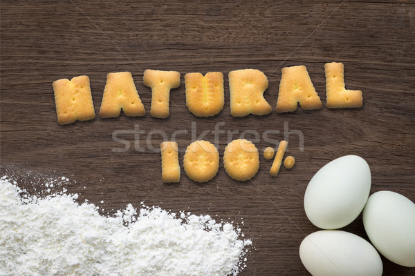 Alphabet cookies word NATURAL on cooking table background Stock photo © vinnstock