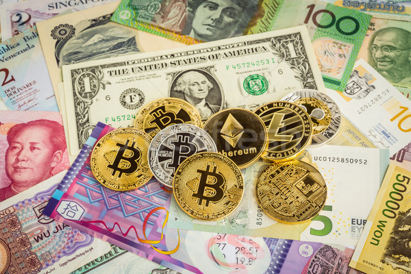 Cryptocurrency set, bitcoins and worldwide money banknotes. Stock photo © vinnstock