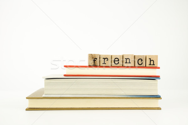 french language word on wood stamps and books Stock photo © vinnstock