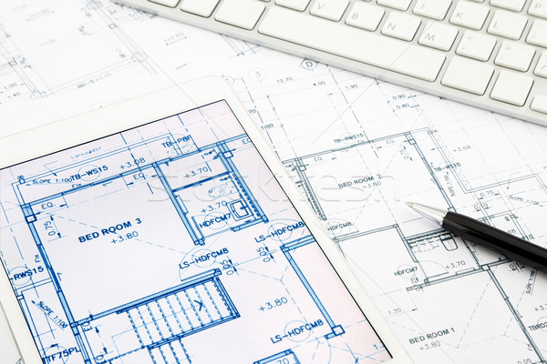 house blueprints and floor plan with tablet Stock photo © vinnstock
