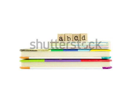 Woord hout postzegels boord boeken Stockfoto © vinnstock