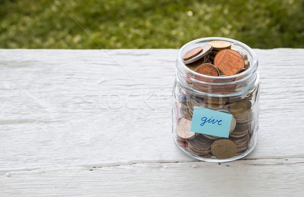 давать деньги благотворительность Мир монетами стекла Сток-фото © vinnstock