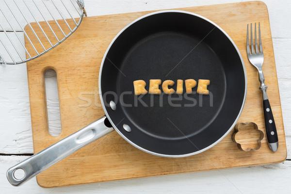 Alfabeto biscoitos palavra receita utensílios de cozinha topo Foto stock © vinnstock