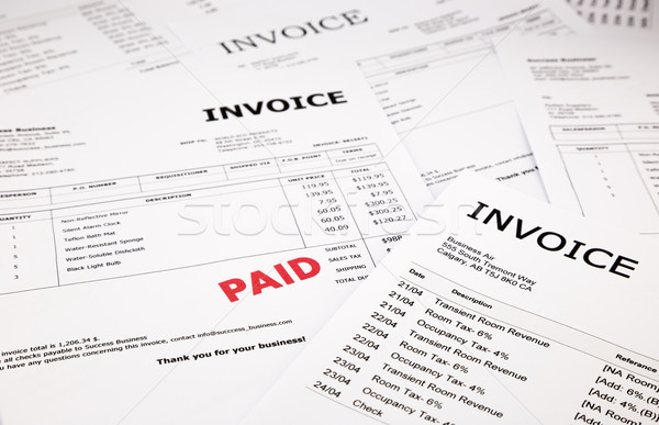invoices and bills with paid stamp  Stock photo © vinnstock