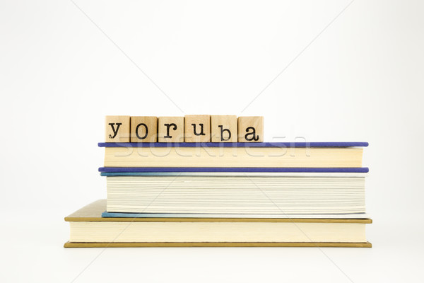 Stock photo: yoruba language word on wood stamps and books