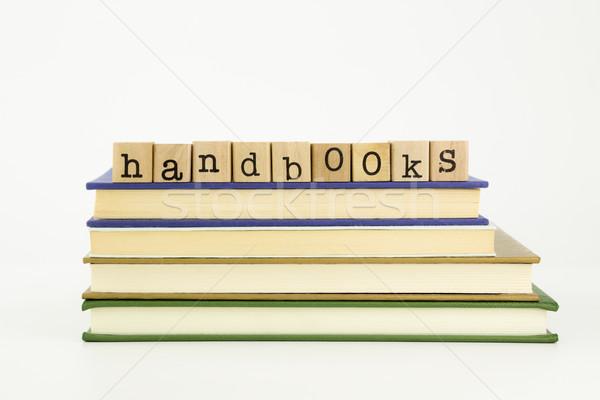 handbooks word on wood stamps and books Stock photo © vinnstock