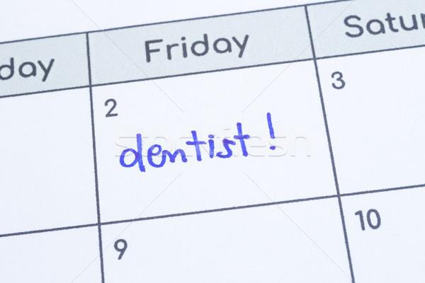 Mot dentiste écrit calendrier page Photo stock © vinnstock