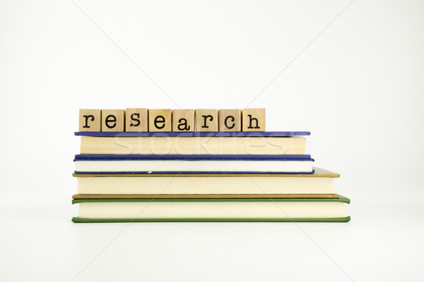 research word on wood stamps and books Stock photo © vinnstock