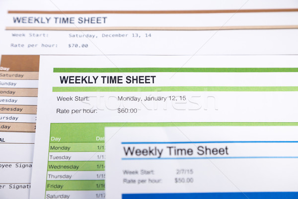 Weekly time sheet forms for payroll Stock photo © vinnstock