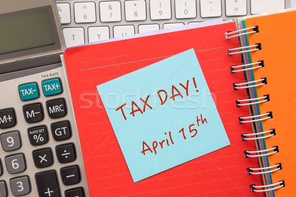 Blue notepad with words ' TAX DAY ' on paper book Stock photo © vinnstock