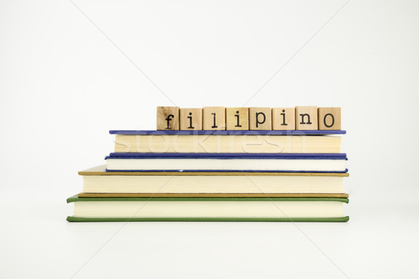 filipino language word on wood stamps and books Stock photo © vinnstock