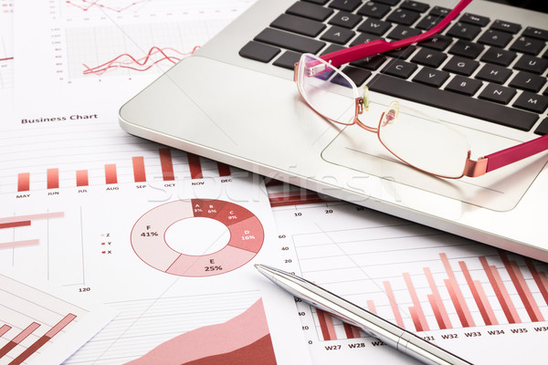 laptop and glasses with red business charts, graphs, research an Stock photo © vinnstock