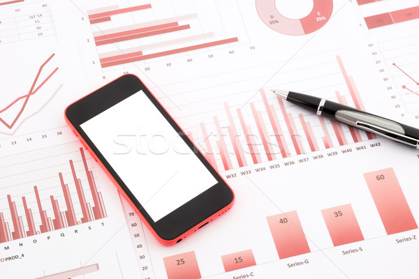 blank mobile phone  on red graphs, charts , data and business re Stock photo © vinnstock