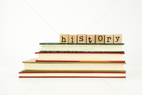 history word on wood stamps and books Stock photo © vinnstock