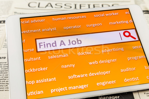 Use tablet search a job or  new career  Stock photo © vinnstock