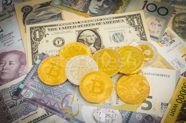 Cryptocurrency bitcoins on worldwide money cash, vintage filter. Stock photo © vinnstock
