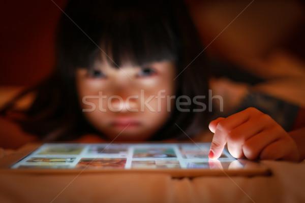 Asya çocuk Internet tablet ekran seçici odak Stok fotoğraf © vinnstock